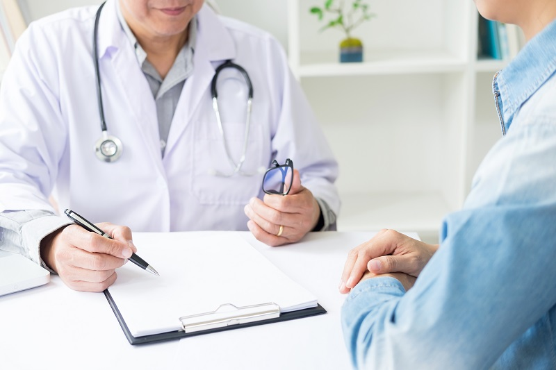 patient listening intently to a male doctor explaining patient s