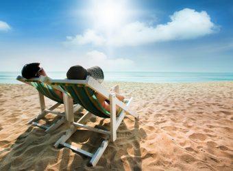 Couple sunbathing on a beach chair and umbrella color The beach