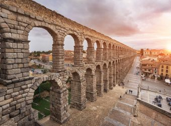 Dramatic sunset in famous Segovia aqueduct, Castilla y leon, Spain.