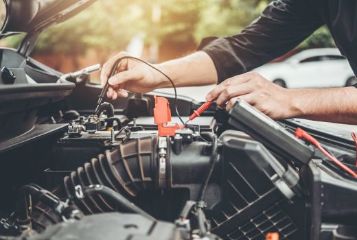 Auto mechanic working in garage Technician Hands of car mechanic