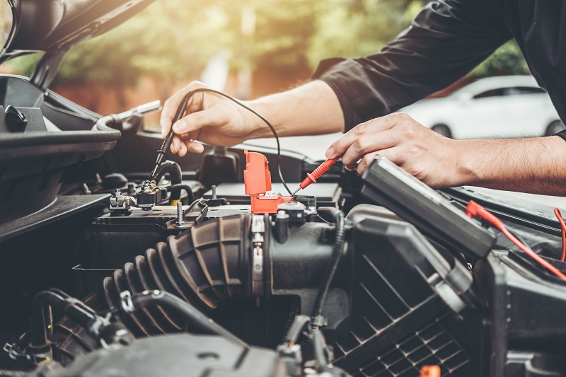 Auto mechanic working in garage Technician Hands of car mechanic