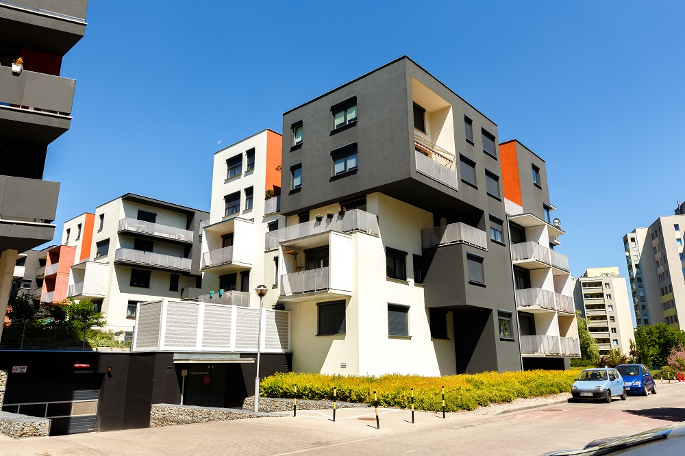 Exterior of a modern  apartment buildings on a blue sky backgrou