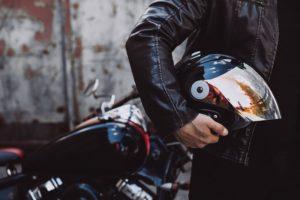 Handsome man biker travelling on mototrcycle