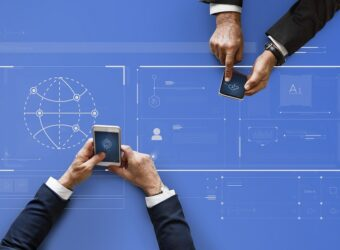 Business people syncing data by mobile phones